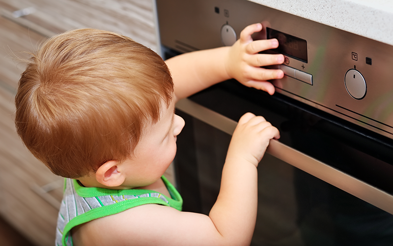 child with oven